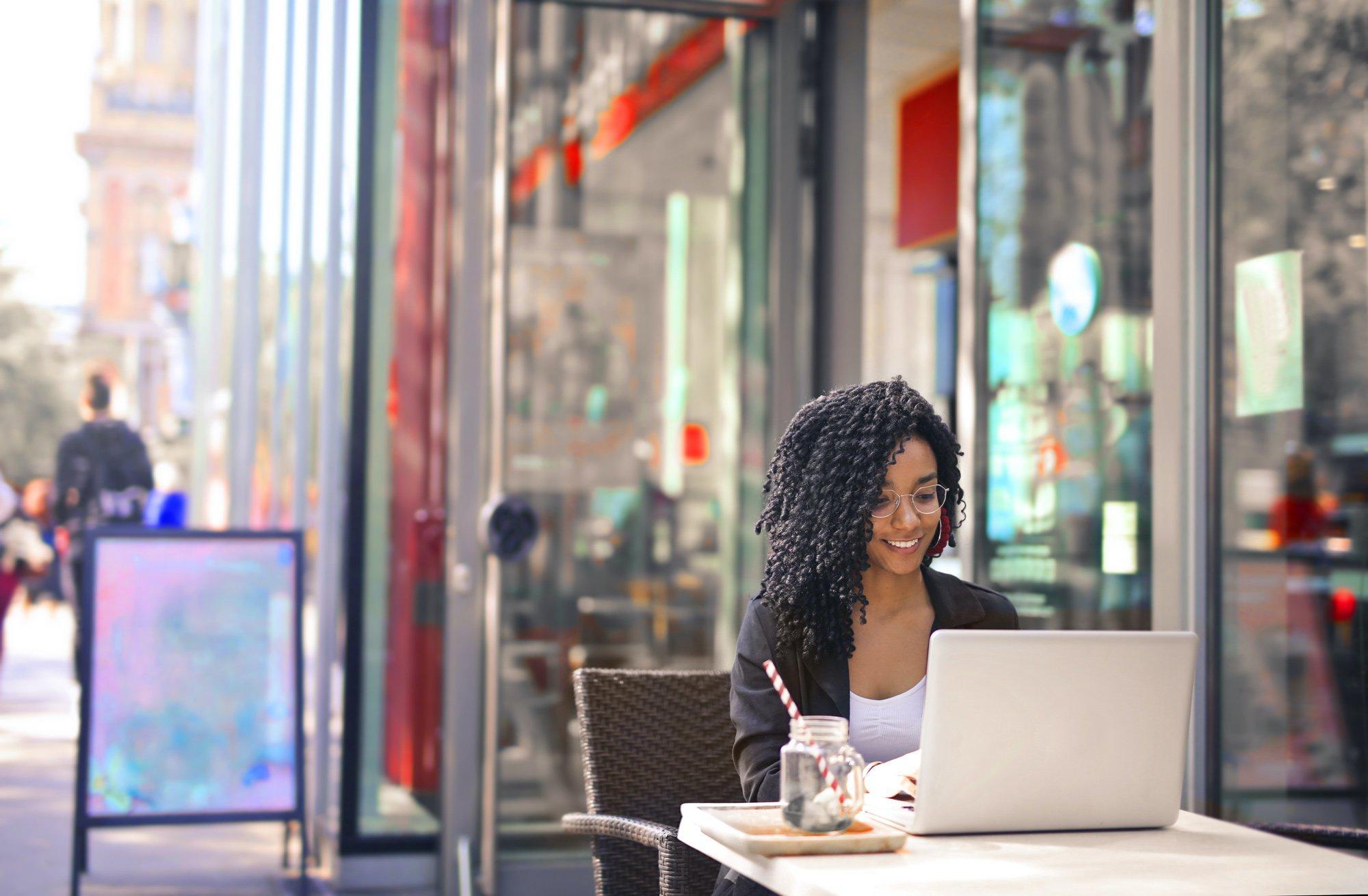Female entrepreneur in Black Long Sleeve Shirt Sitting on Chair learning about entrepreneur tips